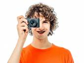 Young man photographer  holding camera portrait — Stock Photo