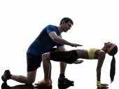 Woman exercising plank position fitness workout with man coach s — Stock Photo