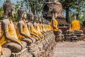 Aligned buddha statues Wat Yai Chai Mongkhon Ayutthaya bangkok T — Stock Photo