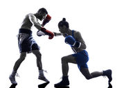 Woman boxer boxing man kickboxing silhouette isolated — Stock Photo