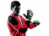 Caucasian soccer player goalkeeper man adjusting gloves silhouet — Stock Photo