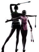 Rhythmic Gymnastics woman  little girl child  teenager silhouett — Stock Photo