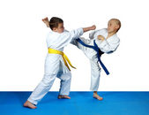 On the blue tatami small athletes are training paired exercises karate — Stock Photo