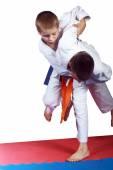 Athlete with orange belt is doing judo throw — Stock Photo
