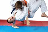 Nage-waza technique in performing sportsman with a blue belt — Stock Photo