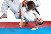 Sportsman with a blue belt doing judo throw — Stock Photo