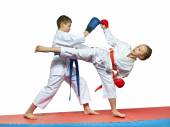 Boy and girl in karategi are training paired exercises karate — Stock Photo