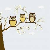 Cute family of owls on a branch with flowers — Stock Vector