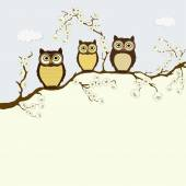Card with family of owls on a branch with flowers — Stock Vector