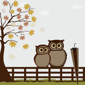 Cute owls on a fence in autumn — Stock Vector