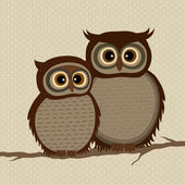 Pair of owls on a branch — Stock Vector
