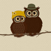 Owls with hats on branch — Stock Vector
