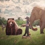 Brave Child in Field with Wild Animals — Stock Photo
