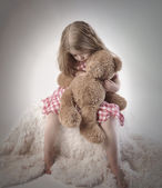 Sad Little Girl Holding Teddy Bear — Stock Photo