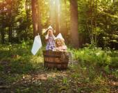 Children Fishing in Wooden Boat in Forest — Stock Photo