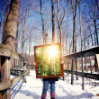 Winter Child Holding Piture Frame of Summer — Stock Photo #73136069