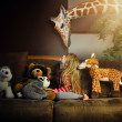 Little Child Playing with Giraffe in House — Stock Photo #73136185