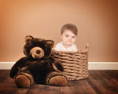 Little Baby Sitting in Basket with Teddy Bear — Stock Photo
