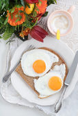 Breakfast with flowers — Stock Photo