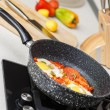 Frying pan with eggs and tomatoes — Stock Photo #54709027