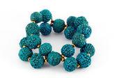Blue wooden beads bracelet — Stock Photo