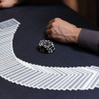 Dealer spreading the deck at poker game — Stock Photo #60780647