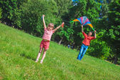 The girl and her father play with a kite. — Stock Photo