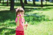 Little girl playing with soap bubbles — Stock Photo