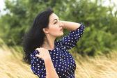 Art portrait of a beautiful brunette — Stock Photo