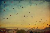 Grunge image  of colorful hot air balloons against blue sky — Stock Photo