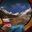 Woman lying in a tent with coffee ,view of mountains and night s — Stock Photo #77137075