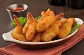Breaded deep fried shrimp — Stock Photo