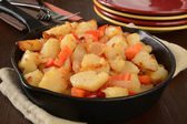 Home fries with peppers and onions — Stock Photo