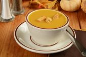 Cup of butternut squash soup — Stock Photo