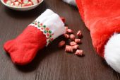 Christmas stocking with candy — Stock Photo