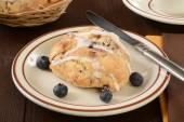 Glazed blueberry scone — Stock Photo