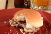 Bitten cheeseburger slider — Stock Photo
