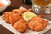 Coconut shrimp and beer — Stock Photo