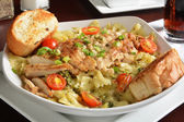 Grilled chicken on pasta — Stock Photo