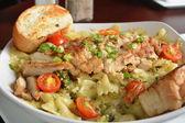 Cajun chicken on bowtie pasta — Stock Photo