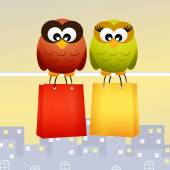 Owls with shopping bags — Stock Photo