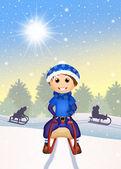 Child on sleigh — ストック写真