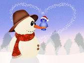 Bird on snowman in winter — 图库照片