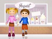 Children eating yogurt — Stock Photo