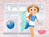 Girl in the laundry — Stock Photo
