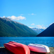 A recreation area with a couple colorful kayaks — Stock Photo #51907079