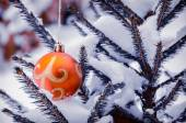 Christmas tree with decoration under snow — Stock Photo