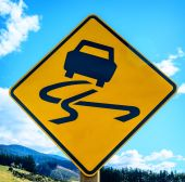 Yellow slippery road sign — Stock Photo