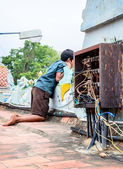 Indian boy near chaotic electrical wiring — Stock Photo