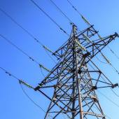 High-voltage tower on blue sky background. — Stock Photo
